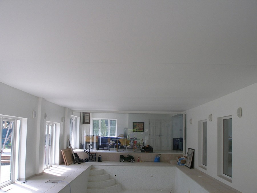 4 stretch ceiling in interior design big room visible seams white matte